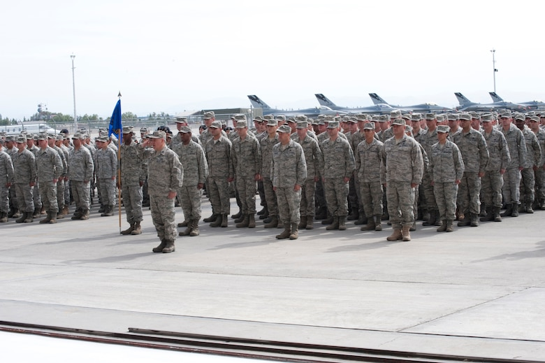 Members of the 144th Fighter Wing, California Air National Guard, come to attention during the recent Change of Command Ceremony held in Fresno, Calif. on May 14, 2011.  The ceremony allows the unit to witness their new leader, Col. Sami D. Said, assume his dutiful position as the Wing Commander.  (U.S. Air force photo by Master Sgt. David Loeffler/released)