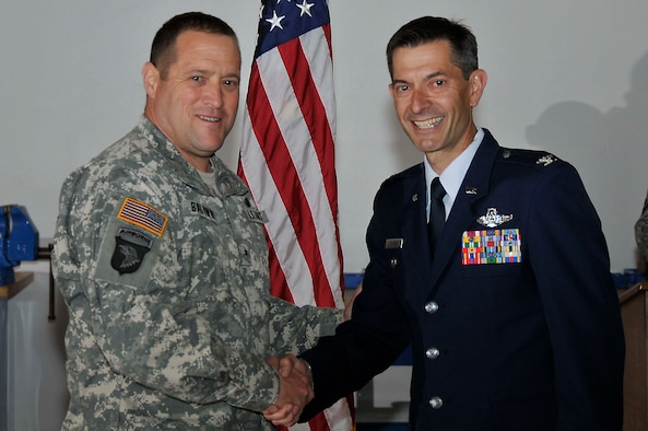 Brig. Gen. David S. Baldwin (left), The Adjutant General of the California National Guard, shakes hands with Col. Steven J. Butow, 129th Rescue Wing Vice Commander, May 14, 2011, at Moffett Federal Airfield, Calif. Colonel Butow was promoted during General Baldwin's visit to the 129th Rescue Wing. (Air National Guard photo by Staff Sgt. Kim Ramirez)