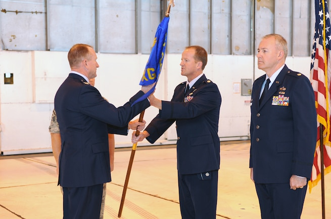 Col. Samuel Ramsay, 151st Air Refueling Wing commander, takes the 151st Maintenance Group flag from outgoing commander Lt. Col Nate C. Nelson to present to the incoming commander, Lt. Col David P. Osborne, during a Change of Command ceremony May 15, 2011. Colonel Osborne took command of the 151st MXG and its approximately 350 Airmen. U.S. Air Force photo by Tech. Sgt. Jeremy Stegall (Released)
