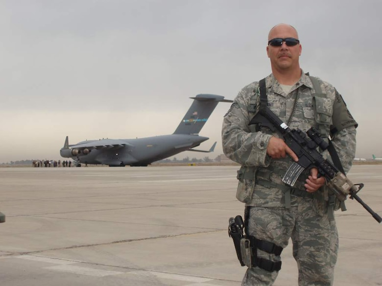Tech. Sgt. Wilford Williams, 151st Security Forces Squadron, Utah Air National Guard, poses in front of a C-17 on a flightline in Iraq. Sergeant Williams is on a six-month deployment to Iraq with the 151st SFS to assist airbase defensive forces in support of Operation New Dawn. U.S. courtesy photo (Released)