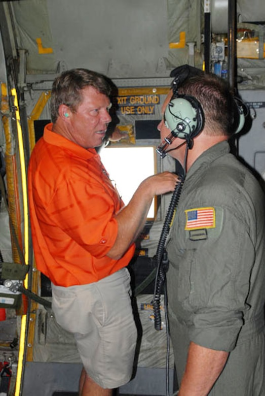 """Master Sgt. Eric Hagen, a loadmaster with the Kentucky Air National Guard 123rd Airlift Wing, Louisville, Ky., discusses flight operations with a Kentucky civic leader during """"Boss Lift"""" Aug. 13, 2010.  The event, sponsored by Employers Support of the Guard and Reserve, is designed to foster support and understanding of the duties, training, and military life National Guard and Reserve troops experience. (Photo by Army Spc. Scott Raper)"""