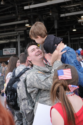 Spc. Allen Anderson from the 19th Special Forces Group, Utah National Guard, greets his son Ethan after returning from a year-long deployment to Iraq. More than 100 members of the unit returned to the Utah Air National Guard Base in Salt Lake City on May 13, 2011. U.S. Air Force photo by Tech. Sgt. Jeremy Giacoletto-Stegall (RELEASED)