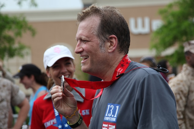 Drew Carey an actor, comedian and Marine who served in the Marine Corps Reserve from 1981-1987 was the official starter of this year's Marine Corps Marathon Historic Half in Fredericksburg, Va., May 14. Carey met his goal of running the half marathon in under 2 hours and finished with a time of 1 hour, 57 minutes and 2 seconds.::r::::n::