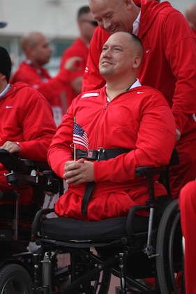 U.S. Marine Lance Cpl. Charles Sketch from Wilgomar, Calif. listening to the playing of the Marines Hymn during the Opening Ceremony of the 2011 Warrior Games at the Olympic Training Center in Colorado Springs, Colo. May 16, 2011. U.S. Army, Marine Corps, Navy and Coast Guard, Airforce, and Special Forces will compete in various events over a period of five days.