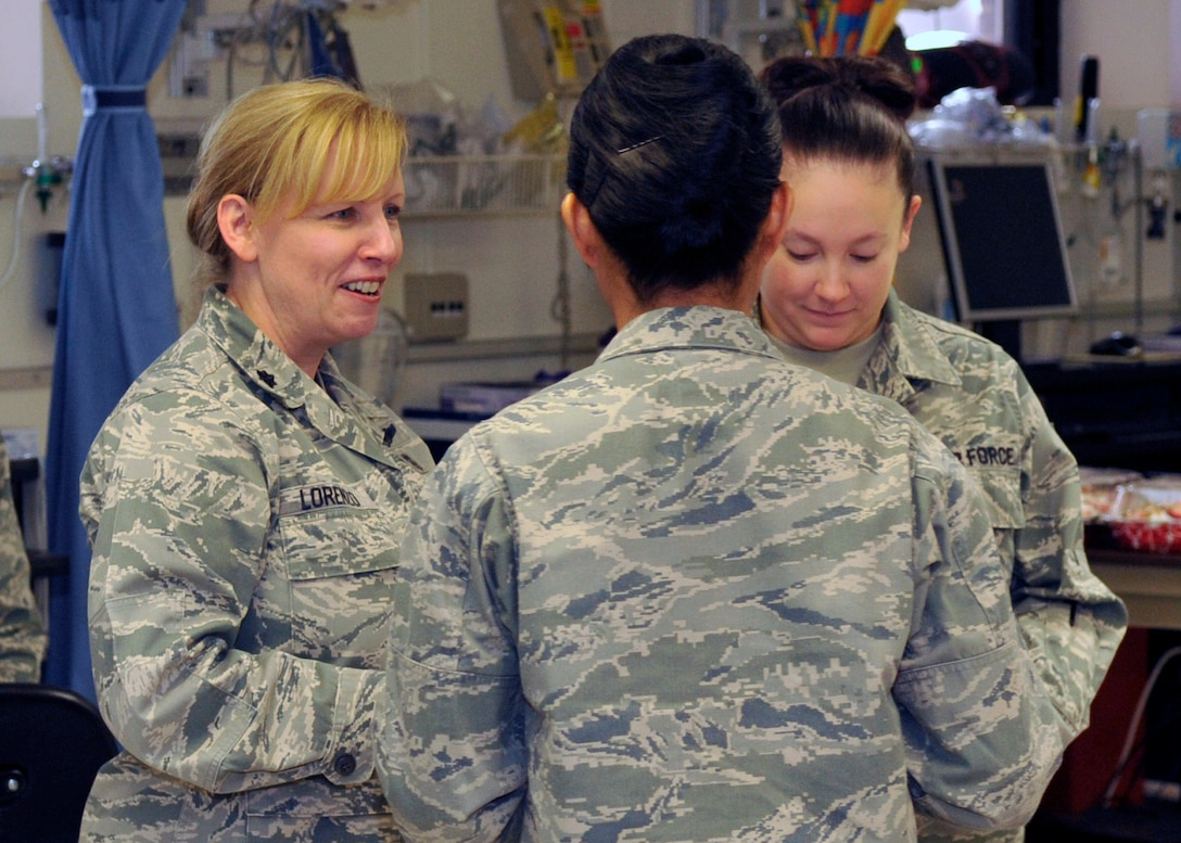 Lieutenant Colonel Kelli Lorenzo, 579th Medical Group Chief Nurse, speaks with fellow nurses from the 779th Medical Group during Nurse/Technician week April 29, 2011. The week ended Thursday, culminating in celebrating the birthday of Florence Nightingale. (U.S. Air Force photo/Senior Airman Laura Turner)