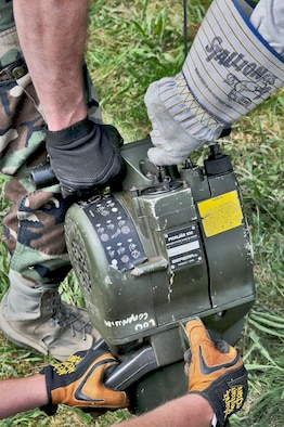 GEROLSTEIN, Germany – Airmen from the 606th Air Control Squadron, use a Pionjar 120 jackhammer to anchor an antenna in the ground to prevent it from falling over as part of exercise Eifel Thunder 2011 in Gerolstein, Germany, May 9. The exercise tested the ability of Airmen to take all their equipment to an isolated location where they set up a deployed radar and satellite communications site as well as everything else required to survive and accomplish the mission in an isolated environment. (U.S. Air Force photo/Senior Airman Nick Wilson)