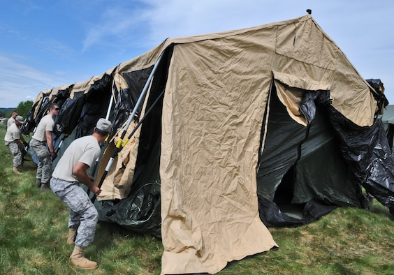 GEROLSTEIN, Germany – Airmen from the 606th Air Control Squadron move and build a tent after arriving to an isolated location as part of exercise Eifel Thunder 2011 in Gerolstein, Germany, May 9. The exercise tested the ability of Airmen to take all their equipment to an isolated location where they set up a deployed radar and satellite communications site as well as everything else required to survive and accomplish the mission in an isolated environment. (U.S. Air Force photo/Senior Airman Nick Wilson)