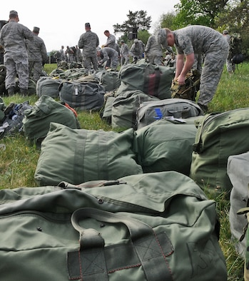 """GEROLSTEIN, Germany – Airmen from the 606th Air Control Squadron organize their luggage after arriving at their """"deployed"""" location as part of exercise Eifel Thunder 2011 in Gerolstein, Germany, May 9. The exercise tested the Airmen's ability to take all their equipment to a deployed location and set up a deployed radar and satellite communications site as well as everything else required to survive and accomplish the mission. The squadron returned to Spangdahlem Air Base May 16. (U.S. Air Force photo/Senior Airman Nick Wilson)"""