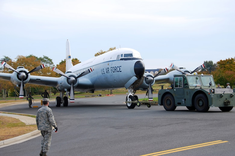 Airmen tow a C-118 Liftmaster from its position as a static display near the passenger terminal at Joint Base McGuire-Dix-Lakehurst, N.J., Oct. 23, 2009. The aircraft is being resurfaced with environmentally friendly paints and will be put back on display by the end of summer. (Tech. Sgt. Shawn J. Jones)