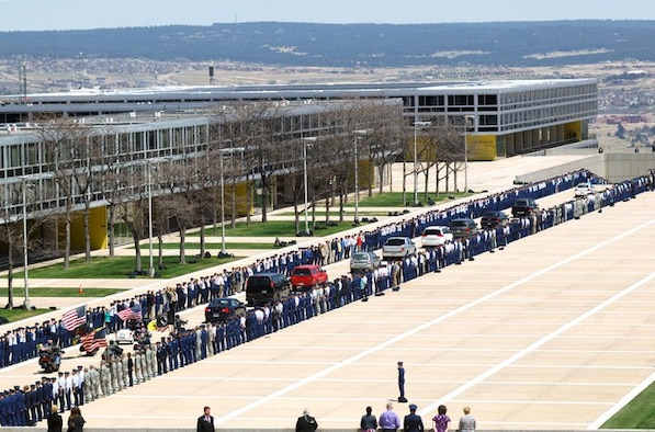 Students and staff memebers at the U.S. Air Force Academy in Colorado Springs line the street as the funeral procession for Maj. Philip Ambard, an academy foreign language professor, passes by. Maj. Ambard, a father of five, lost his life while deployed in Kabul, Afghanistan. (U.S. Air Force Courtesy Photo)