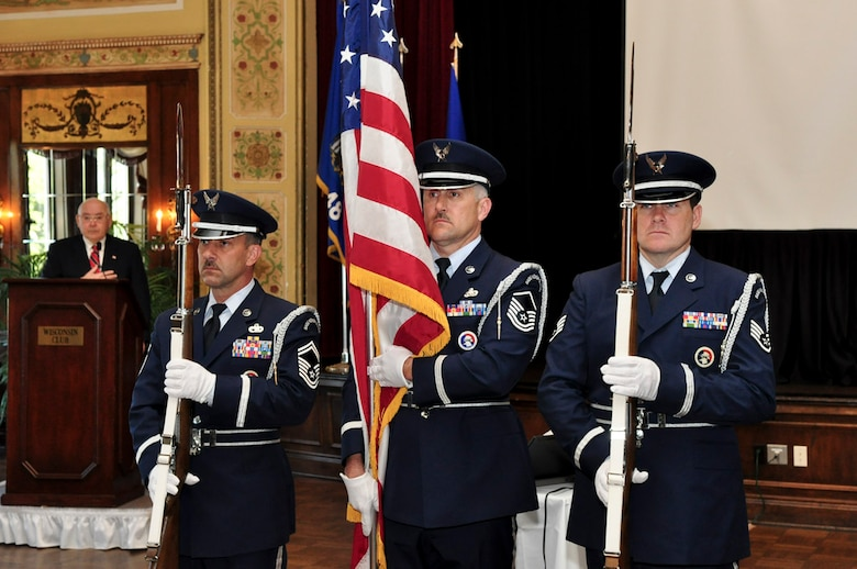 Members of Milwaukee's128th Air Refueling Wing Honor Guard present the colors during the ESGR breakfast held at the Wisconsin Club in downtown Milwaukee, May 16, 2011.  Each year the Milwaukee Armed Forces Committee and Wisconsin Committee for Employer Support of the Guard and Reserve (ESGR) recognize the men and women who serve the armed forces and the employers that support them. U.S. Air Force photo by Tech Sgt. Thomas J Sobczyk  / Released