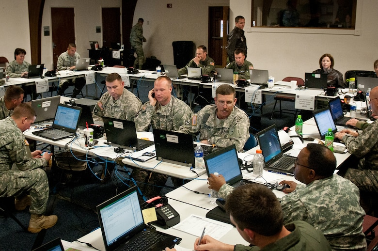 Airmen and Soldiers from the Kentucky National Guard staff a Joint Air Operations Center at the Kentucky Air National Guard Base In Louisville, Ky., on May 17, 2011. The JAOC is supporting a major earthquake-response exercise by prioritizing and allocating air assets for missions into affected areas across the state. (U.S. Air Force Photo by Capt. John T. Stamm)