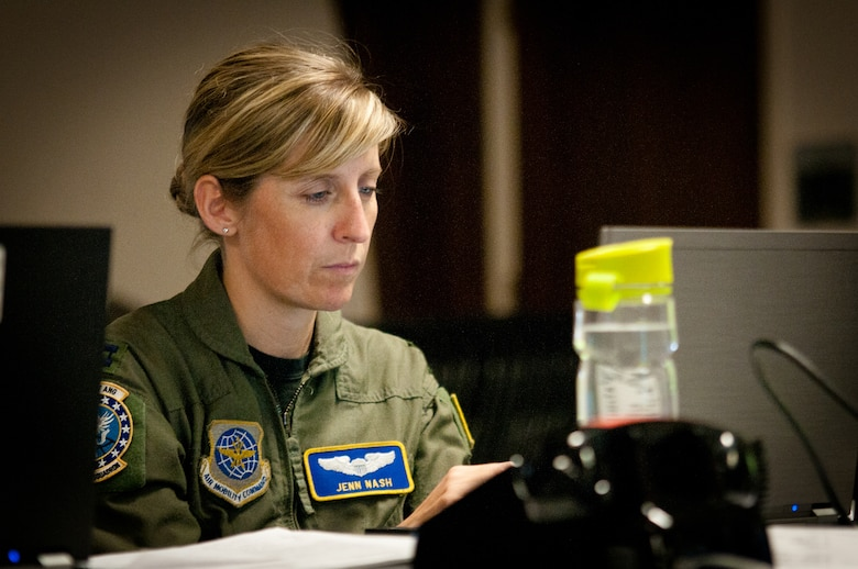 Capt. Jenn Nash coordinates long-range mission planning for the Joint Air Operations Center at the Kentucky Air National Guard Base In Louisville, Ky., on May 17, 2011.  The JAOC is supporting a major earthquake-response exercise by prioritizing and allocating air assets for missions into affected areas across the state. (U.S. Air Force Photo by Capt. John T. Stamm)