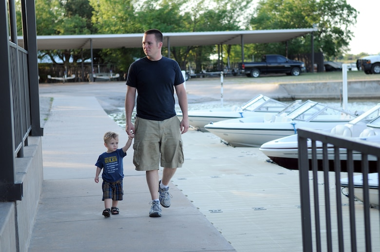 GOODFELLOW AIR FORCE BASE, Texas --Staff Sgt. Adam Rodgers an instructor with the 315th Training Squadron takes his son Nicolas for a walk at Goodfellow's Recreation Camp on Lake Nasworthy, May 14. The 17th Force Support Squadron's Outdoor Recreation Center offers various activities for all ages. 