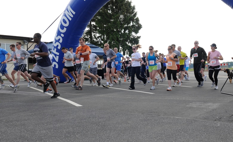 SPANGDAHLEM AIR BASE, Germany – Runners take off from the starting line during the 10K and U.S. Air Forces in Europe half marathon in the parking lot behind the Skelton Memorial Fitness Center here May 14. The USAFE half marathon is an annual event Airmen from around Europe can participate in. Each run was split into different categories based on age and gender. (U.S. Air Force photo/Airman 1st Class Brittney Frees)