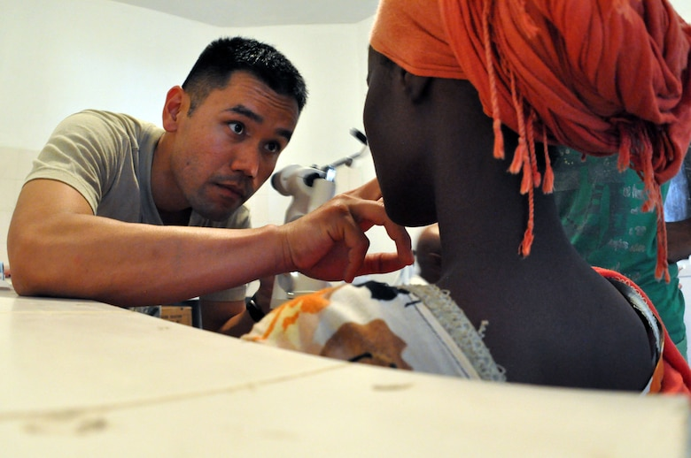 OBOCK, Djibouti - U.S. Air Force Capt. Alex Kwon performs an eye examination on a patient in Obock, Djibouti, during a Medical Capacity Program (MEDCAP) mission, May 5. Combined Joint Task Force – Horn of Africa (CJTF-HOA) optometrists performed vision checks and provided prescription glasses to patients during the two-day event. The success of this MECAP relied heavily on teamwork from the Djiboutian Health Ministry personnel, local care providers and 20 soldiers assigned to the 402nd Civil Affairs Battalion, currently attached to CJTF. (U.S. Air Force photo by Lt. Col. Leslie Pratt)