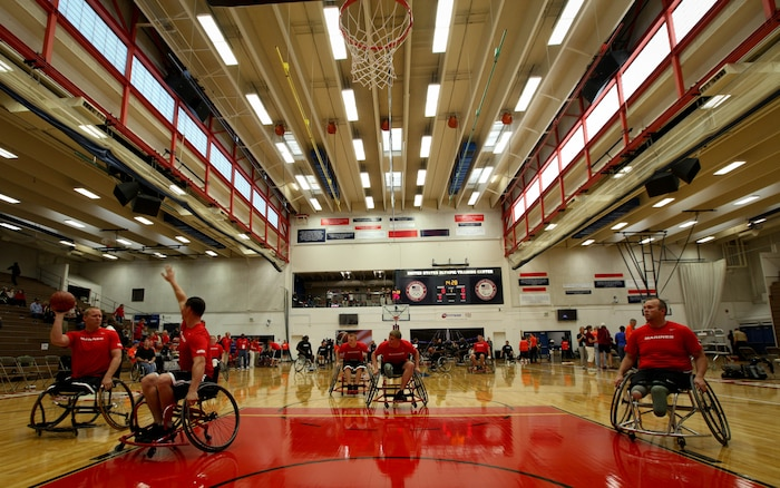 The All-Marine wheelchair basketball team practices before their game against the Army May 17, 2011, at the 2011 Warrior Games in Colorado Springs, Colo. Wheelchair basketball is a five-on-five game consisting of two 20-minute halves, and each team is required to have two players with lower limb impairments. The game is also a round robin event. All teams will compete against each other and seed based on their standings.