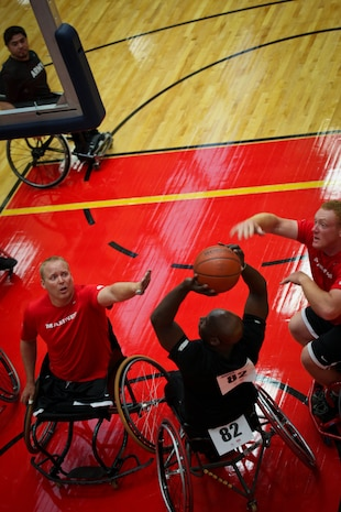 Lance Cpl. Joshua Wege and Marine veteran Cpl. Travis Green of the All-Marine wheelchair basketball team face an All-Army member during the Marines vs. Army wheelchair basketball game May 17, 2011, at the Warrior Games in Colorado Springs, Colo. The Army went on to beat the Marines 33-21 in the first game of the round robin series. Wheelchair basketball is a five-on-five game consisting of two 20-minute halves, and each team is required to have two players with lower limb impairments. The game is also a round robin event. All teams will compete against each other and seed based on their standings.
