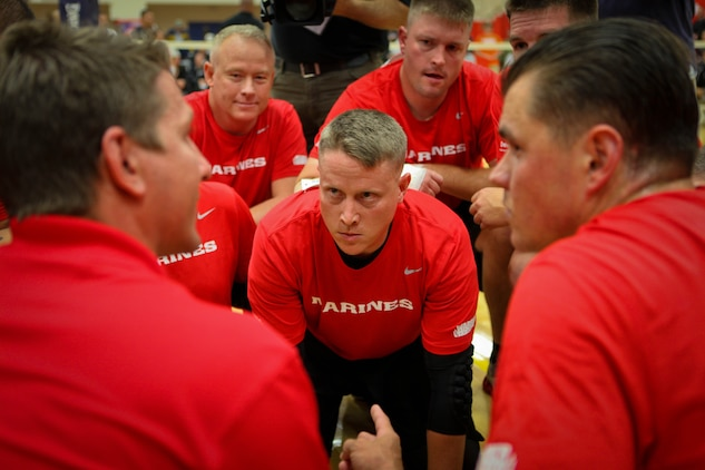 Staff Sgt. Jedidiah Vermillion of the All-Marine sitting volleyball team brought a lot of intensity to a pre-game meeting before the Marines took on the Army in sitting volleyball during the Warrior Games May 17, 2011, at the Olympic Training Center in Colorado Springs, Colo. The Marines beat the All-Army team in a best-of-three competition. They later took down the Special Operations Command team.