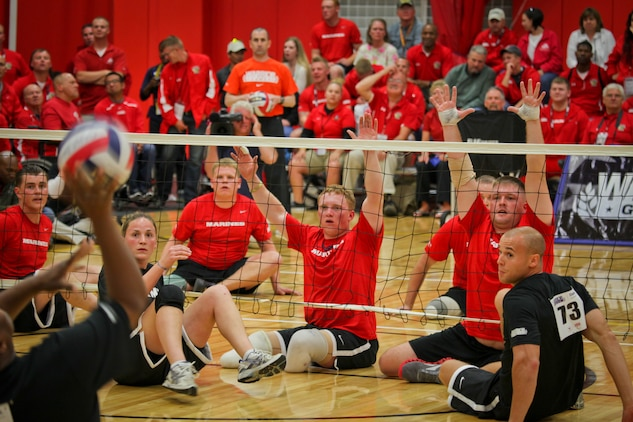 Lance Cpl. Joshua Wege and Marine veteran Cpl. Richard Bacchus were a paramount force in front of the net when the All-Marine sitting volleyball team took down the All-Army team during the Warrior Games May 17, 2011, at the Olympic Training Center in Colorado Springs, Colo. The Marines later beat the Special Operations Command team and are slated to take on the Air Force team May 18, 2011.