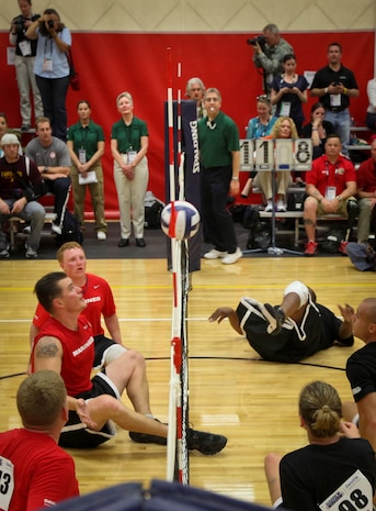 Sgt. Stephen Lunt of the All-Marine sitting volleyball team prepares to return a short shot from the Army during their first sitting volleyball game of the Warrior Games May 17, 2011, at the Olympic Training Center in Colorado Springs, Colo. The Marines beat the All-Army team in a best-of-three competition. They later took down the Special Operations Command team.