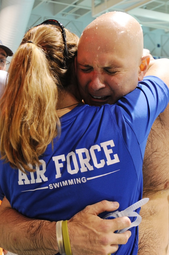 Air Force coach Cami Stock hugs Retired Chief Master Sgt. Damian