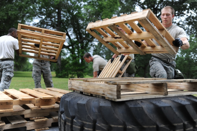 Airman 1st Class Joseph Schlank practices building up a pallet during the preparation for the confidence course at the Rodeo competition, where the 437th Aerial Port Squadron Rodeo team will be tested against numerous other base's teams over career field knowledge, endurance, speed, teamwork as well as safety at Joint Base Lewis-McChord, Wash. (U.S. Air Force photo/Staff Sgt. Katie Gieratz)(RELEASED)