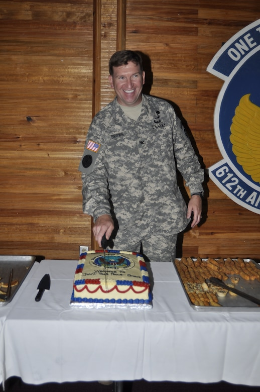SOTO CANO AIR BASE, Honduras - Col. Ross A. Brown, Joint Task Force-Bravo commander, cuts his cake during a reception following his change of command ceremony here, May 18. (Department of Defense photo/Martin Chahin)