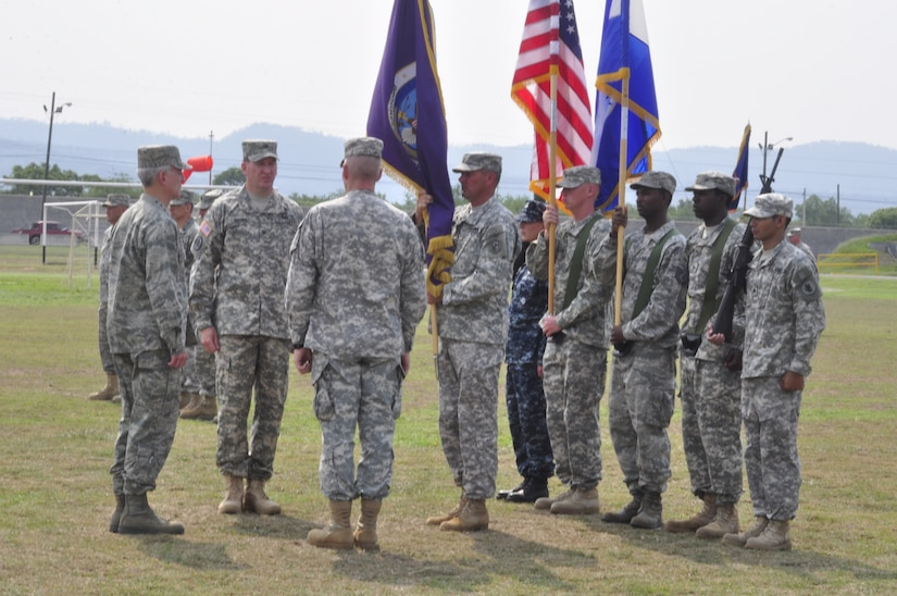 SOTO CANO AIR BASE, Honduras - Joint Task Force-Bravo Command Sergeant Major Karl J. Groninger presents the JTF-B flag so Gen. Douglas M. Fraser, U.S. Southern Command commander can pass command from Col. Gregory D. Reilly to Col. Ross A. Brown during a change of command ceremony here, May 18. (Department of Defense photo/Martin Chahin)