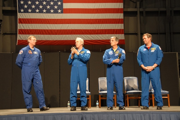 Picture of four astronauts. (From left-right) Air Force Col. (Ret) Mark Brown, Dr. Thomas Jones, Dr. Donald Thomas and Navy Capt. (Ret) Michael Foreman answer questions from the audience during Space Night 2011 at the National Museum of the U.S. Air Force. (U.S. Air Force photo).
