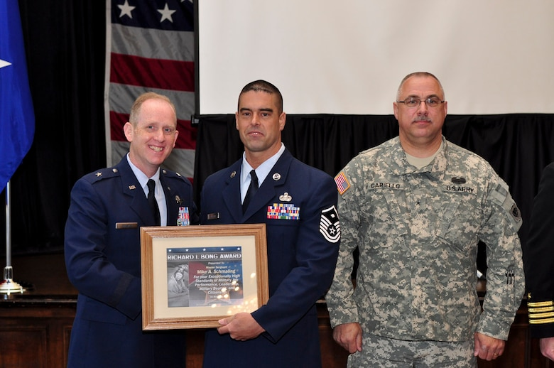 Master Sergeant Mike A. Schmaling of the 128th Air Refueling Wing receives the Bong Award during the ESGR breakfast held at the Wisconsin Club in downtown Milwaukee, May 16, 2011. Each year the Milwaukee Armed Forces Committee and Wisconsin Committee for Employer Support of the Guard and Reserve (ESGR) recognize the men and women who serve the armed forces and the employers that support them. U.S. Air Force photo by Tech Sgt. Thomas J Sobczyk / Released