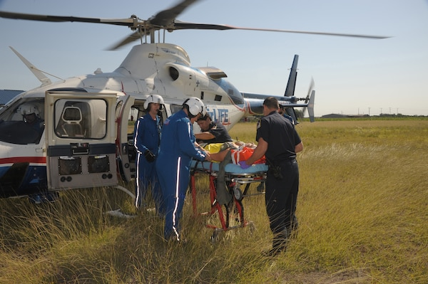 San Antonio AirLife  and Seguin fire department personnel prepare to place Staff Sgt Jennifer Swain, 359th Dental Squadron into the AirLife Helicopter May 17, during a practice exercise  in Seguin, Texas.  Exercises take place often to keep military as well as nearby community personnel, trained and prepared for any emergency. (U.S. Air Force photo/Joel Martinez) (released)