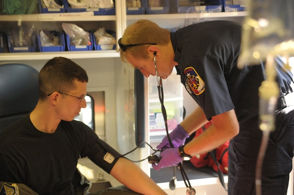 2nd Lt Travis Chase, 12th Operations Support Squadron,  is treated by Seguin Fire department paramedic James Talbots, during an exercise May 17.  The exercise, which involved response forces from Seguin, Texas, and Randoph Air Force Base, allowed an opportunity to train and prepare military and community peersonnel for real world emergencies.  (U.S. Air Force photo/Joel Martinez) (released)