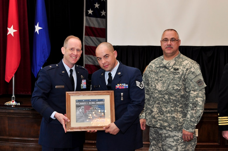 Staff Sergeant Edel Rojas of the 347th Recruiting Squadron receives the Bong Award during the ESGR breakfast held at the Wisconsin Club in downtown Milwaukee, May 16, 2011.  Each year the Milwaukee Armed Forces Committee and Wisconsin Committee for Employer Support of the Guard and Reserve (ESGR) recognize the men and women who serve the armed forces and the employers that support them. U.S. Air Force photo by Tech Sgt. Thomas J Sobczyk  / Released