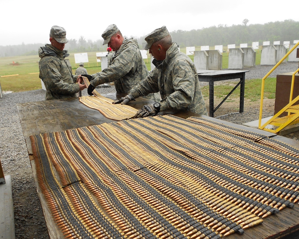 Members of the 118th Airlift Wing Security Forces count their ammunition during a training exercise in Tullahoma May 15, 2011.