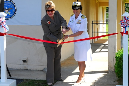 Carolyn Adams and Capt. Paula McClure cut the ribbon for the grand opening of the Joint Veteran's Administration Optometry clinic at Joint Base Charleston-Weapons Station, May 17. The facility is Charleston's first joint initiative between the Department of Veterans Affairs and the Department of Defense. The clinic offers optometry and audiology services for veterans, DoD dependents and retirees and will be staffed by five full-time  employees. Ms. Adams is the  Ralph H.Johnson Veteran Affairs Medical Center director and Captain McClure is the Naval Health Clinic Charleston commander. (U.S. Navy photo/ Machinist's Mate 3rd Class Brannon Deugan)