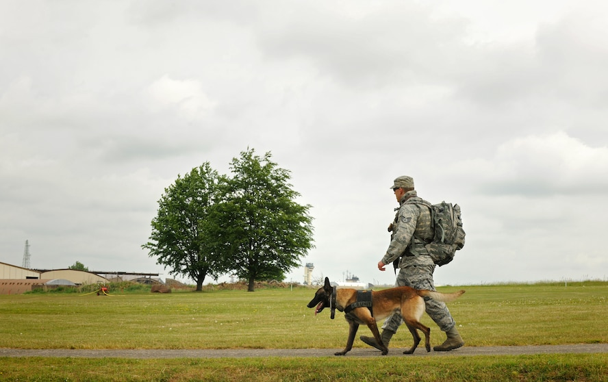 SPANGDAHLEM AIR BASE, Germany – Staff Sgt. Michael Longero and his dog Ushur, 52nd Security Forces Squadron, walk around the base during a ruck march as part of National Police Week here May 17. The ruck march was held in remembrance of the Air Force security forces members who have died in support of Operation Iraqi Freedom and Operation Enduring Freedom. (U.S. Air Force photo/Senior Airman Nathanael Callon)