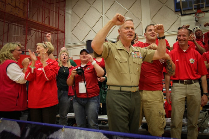 Commandant of the Marine Corps Gen. James F. Amos celebrates a point served by the All-Marine sitting volleyball team during their game against the Air Force May 18, 2011, at the Olympic Training Center in Colorado Springs, Colo., during the Warrior Games. The Marines blew out the Air Force team in a best-of-three series.