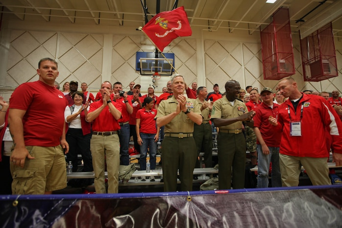Commandant of the Marine Corps Gen. James F. Amos and Sergeant Major of the Marine Corps Sgt. Maj. Carlton Kent celebrate the points the All-Marine sitting volleyball team are racking up against the Air Force team May 18, 2011, at the Olympic Training Center in Colorado Springs, Colo. The Marines blew out the Air Force team in a best-of-three series.