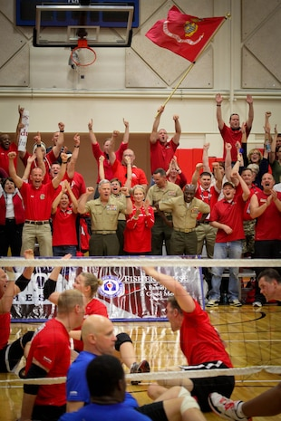 The Marines took down the All-Air Force sitting volleyball team in a victories best-of-three series during the Warrior Games May 18, 2011, at the Olympic Training Center in Colorado Springs, Colo. Commandant of the Marine Corps Gen. James F. Amos and Sergeant Major of the Marine Corps Sgt. Maj. Carlton Kent surprised the Marines when they arrived to cheer on the team.