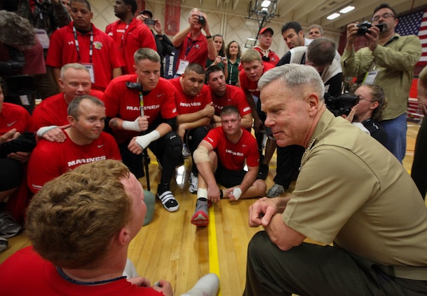 Commandant of the Marine Corps Gen. James F. Amos held an end-of-game team meeting with the All-Marine sitting volleyball team during the Warrior Games May 18, 2011, at the Olympic Training Center in Colorado Springs, Colo. The Marines beat the All-Air Force team in a best-of-three series in sitting volleyball. Amos told the Marines he's really proud of them and their success.