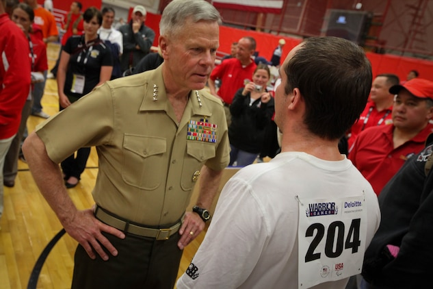 Commandant of the Marine Corps Gen. James F. Amos speaks with John Stanz, a Marine on the Special Operations Command sitting volleyball team during the Warrior Games May 18, 2011, at the Olympic Training Center in Colorado Springs, Colo.