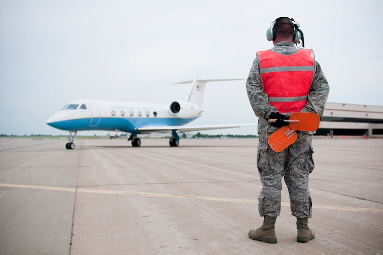 Sgt. Brandon Harris, a crew chief with the 123rd Contingency Response Element, Kentucky Air National Guard, marshals a Gulfstream G450 Jet at Springfield-Branson National Airport in Springfield, Mo., on May 18, 2011, during National Level Exercise 2011. On board is William Craig Fugate, director of the Federal Emergency Management Agency, who arrived in Springfield to take questions from news media about the exercise and view the collaboration between civil authorities and the Department of Defense. The exercise is based on scenario involving a massive earthquake along the New Madrid fault line. (U.S. Air Force photo by Senior Airman Maxwell Rechel)