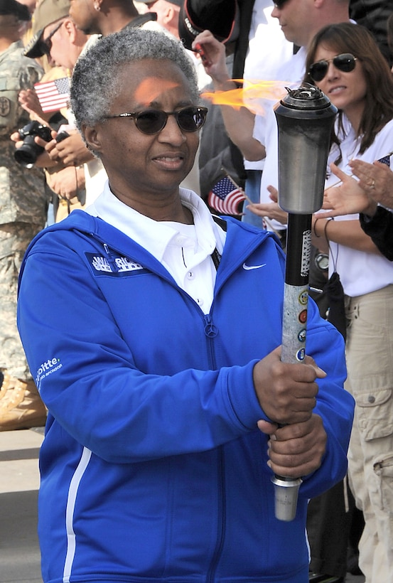 Retired Maj. Gwendolyn Sheppard caries the torch during the opening ceremony of the 2011 Warrior Games May 16, 2011, in Colorado Springs, Colo. Major Sheppard was selected by her teammates for the honor of being the torch bearer for the Air Force team. (U.S. Air Force photo/Duncan Wood)