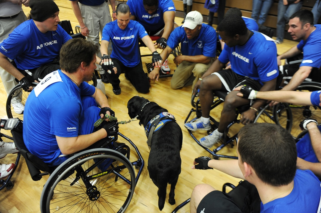 Members of the Air Force wheelchair basketball team gather for a time out May 18, 2011, during the Warrior Games at the U.S. Olympic Training Center in Colorado Springs, Colo. Some 200 wounded warriors and disabled veterans from all of the military services competed in paralympic-style athletic events May 16 to 21. (U.S. Air Force photo/Staff Sgt. Desiree N. Palacios)