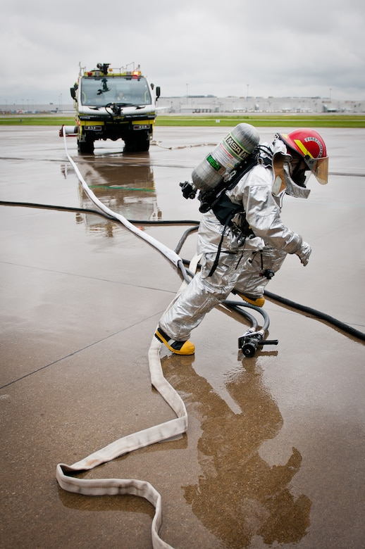 A member of the Louisville Regional Airport Authority Fire Department responds to a simulated plane crash during earthquake-response exercises held May 18, 2011, at the Kentucky Air National Guard Base in Louisville, Ky. The exercises were designed to test the capabilities of government agencies following a major earthquake along the New Madrid fault line. (U.S. Air Force photo by Maj. Dale Greer)