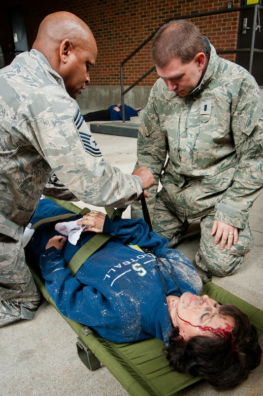 Chief Master Sgt. Jimmy Rogers (left) and 1st Lt. Thomas Hagan of the Kentucky Air National Guard's 123rd Medical Group examine a simulated plane-crash victim during earthquake-response exercises held May 18, 2011, at the Kentucky Air National Guard Base in Louisville, Ky. The exercises were designed to test the ability of the Department of Veterans Affairs and the Kentucky Air Guard to provide medical care following a major earthquake along the New Madrid fault line. (U.S. Air Force photo by Maj. Dale Greer)
