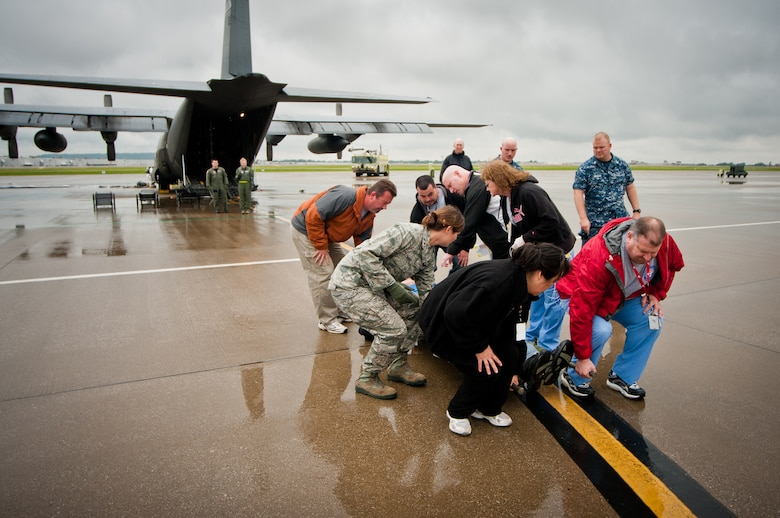 Volunteers for the National Disaster Medical System carry simulated patients off a C-130 during a earthquake-response exercise held May 18, 2011, at the Kentucky Air National Guard Base in Louisville, Ky. Operated by the U.S. Department of Health and Human Services with volunteers from multiple agencies like the Department of Veterans Affairs, NDMS was created to manage the federal government's overall medical response to major emergencies and disasters. (U.S. Air Force photo by Maj. Dale Greer)