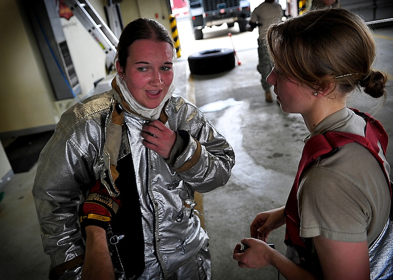 Cadets 3rd class Victoria Cachro and Randi Imerman (L-R) talk after the firefighters physical training challenge.  U. S. Air Force Academy cadets participated in field training with 51st Civil Engineer firefighters May 18.