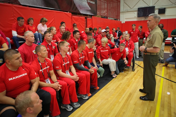 Commandant of the Marine Corps Gen. James Amos said he's very proud of the All-Marine team's success during a visit May 19, 2011, at the Olympic Training Center in Colorado Springs, Colo. Amos and Sgt. Maj. of the Marine Corps Carlton Kent were sitting front row watching the All-Marine sitting volleyball team shut down the All-Air Force team the previous night. The 48-member team, consisting of active-duty and veteran wounded, ill or injured Marines, are going head-to-head against the other branches of the Armed Forces to defend its 2010 title.